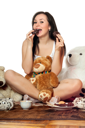 Royalty Free Photo of a Young Brunette Eating Biscuits