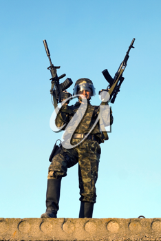 Royalty Free Photo of a Soldier With Two Rifles