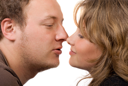 Royalty Free Photo of a Couple About to Kiss