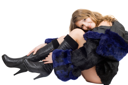 Royalty Free Photo of a Girl in a Coat and Boots