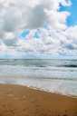 Cloudy blue sky over the stormy sea