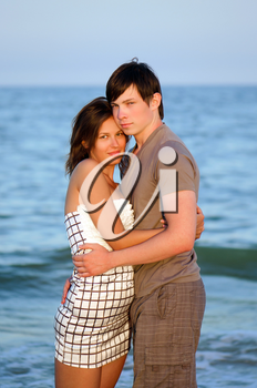 Closeup portrait of a happy young couple on the beach