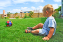 Royalty Free Photo of a Little Boy Playing