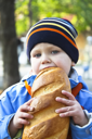 Royalty Free Photo of a Little Boy Eating Bread