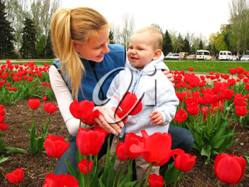 Royalty Free Photo of a Mother and Son in a Garden