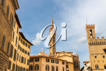 Bell tower of Palazzo del Bargello and church spire of Badia Fiorentine   in Florence, Italy
