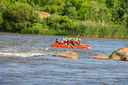 NIKOLAEV, VILLAGE GRUSHEVKA, UKRAINE - MAY 23, 2014: Rafting tourists with an experienced instructor on the river Southern Bug