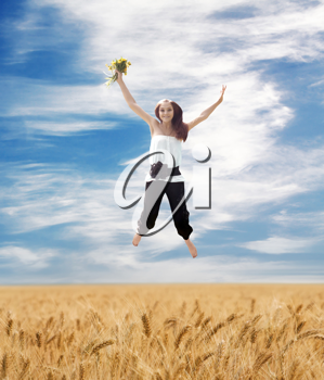 Beautiful Summer Landscape And Flying Young Woman With Bouquet Of Dandelions