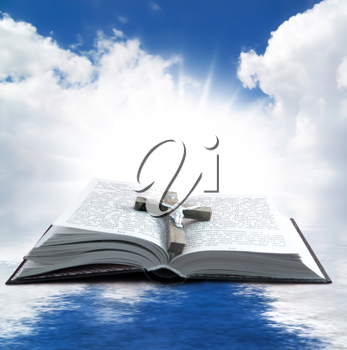 Prayer Holy book on the background of clouds and sun