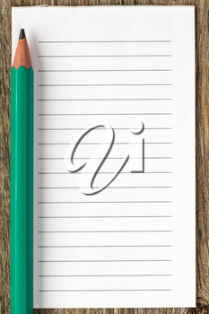 Pencil and blank lined paper for your text