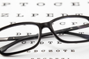 Clear black modern glasses on a eye sight test char