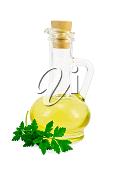 Vegetable oil in a glass carafe with a sprig of parsley isolated on white background