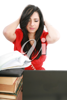 Young tired business woman with headache sitting at computer in workplace holding head