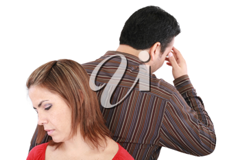 Young couple standing back to back having relationship difficulties. Focus on woman