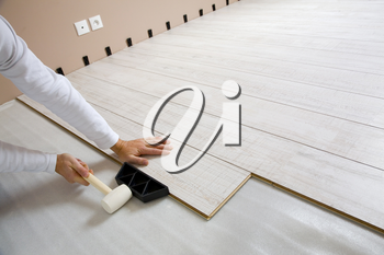 Royalty Free Photo of a Person Laying Laminate Floor