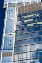 Royalty Free Photo of Two Window Washers on a Skyscraper