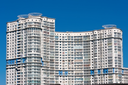 Beautiful view of modern apartment building under blue sky