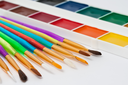 Set of artistic brushes and paints on white background