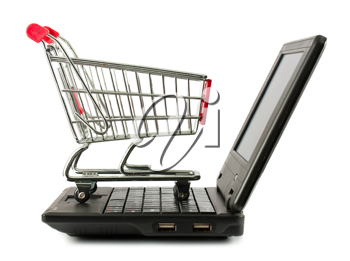 Royalty Free Photo of a Shopping Cart Sitting on a Keyboard of a Laptop Computer