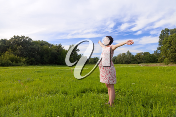 Royalty Free Photo of a Pregnant Woman in a Field