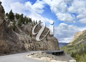 Royalty Free Photo of a Winding Mountain Road In The Yellowstone National Park