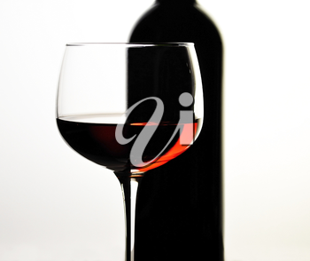 red wine glass and bottle  , close up
