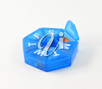 a blue pill box on white background