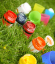 Bright paint colors in the tubes in green grass