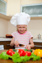 Royalty Free Photo of a Little Girl Preparing Food