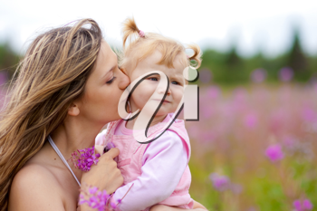 Royalty Free Photo of a Mother and Daughter in a Meadow