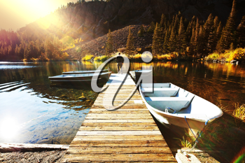 Royalty Free Photo of a Dock in Autumn Lake