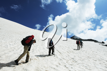 Royalty Free Photo of Hikers on a Snowy Mountain
