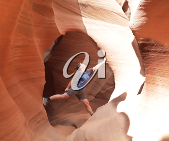 Royalty Free Photo of a Woman Climbing in a Canyon