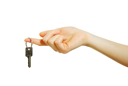 Royalty Free Photo of a Person Holding a Key