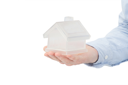 Royalty Free Photo of a Person Holding a Model of a House