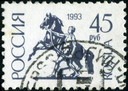 RUSSIA - CIRCA 1992: A stamp printed in Russia shows Sculpture rider leading the horse by the bridle on Anichkov Bridge in St Petersburg, circa 1992