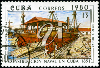 CUBA - CIRCA 1980: A stamp printed by the Cuban Post shows construction of two Cuban steamships Congreso ; and Colon, built in 1851, circa 1980