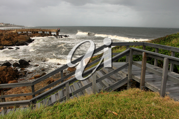 Picture of Wooden Steps and Concrete Jetty in Storm over Sea