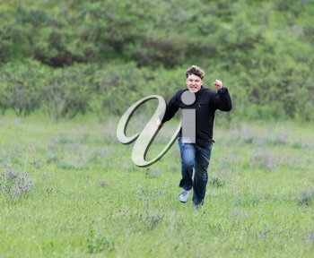 man running in a meadow