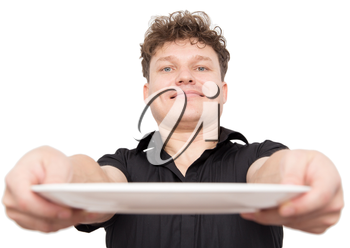 Chef cook holding an empty plate on white background