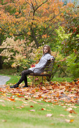 Royalty Free Photo of a Woman Sitting on a Bench