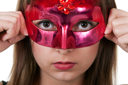 Royalty Free Photo of a Girl in a Mask