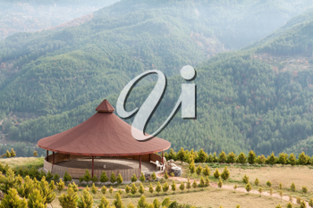 Royalty Free Photo of an Arbor With a Round Roof in the Mountains