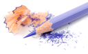 Color pencil with sharpening shavings on white background