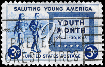 Royalty Free Photo of 1948 US Stamp Shows the Girl and Boy Carrying Books, Youth of America and Youth Month