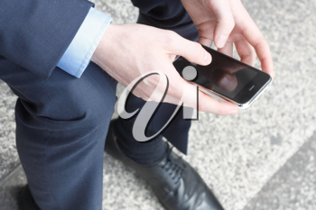 Royalty Free Photo of a Businessman Using a Cellphone