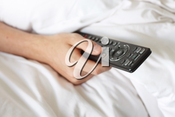 Royalty Free Photo of a Person Watching TV in Bed