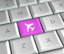 Royalty Free Photo of an Airplane Button on a Keyboard