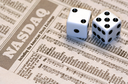 Royalty Free Photo of Dice on a Newspaper