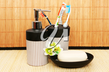 Royalty Free Photo of Soap Dispensers and Toothbrushes